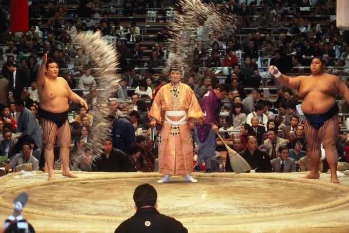 Purifying the ring – Wrestlers sprinkling salt